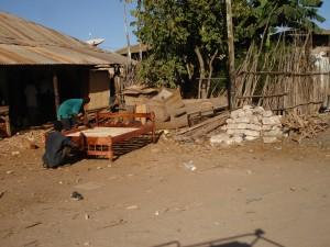 Bed making in downton Malindi - Turists must take care in Kenya.